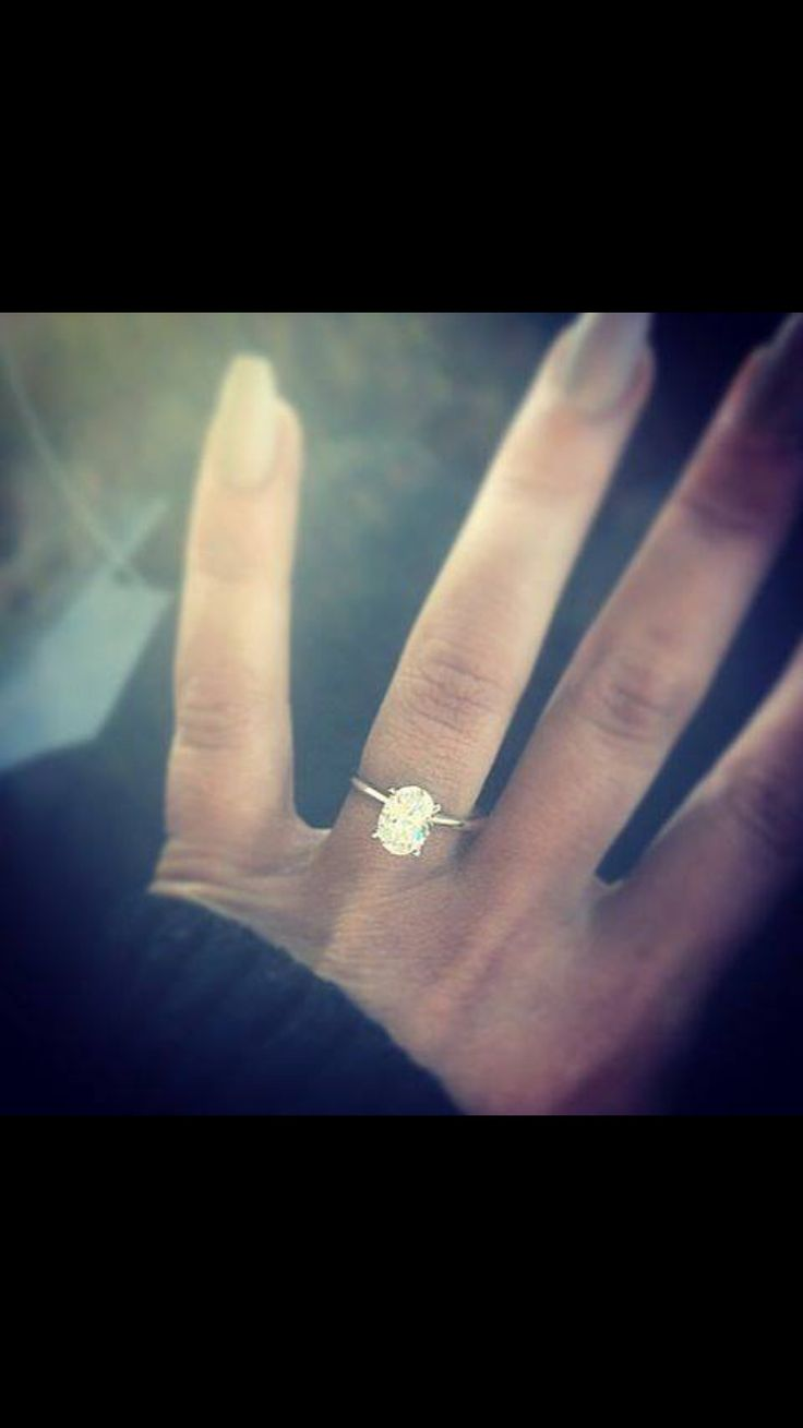 LOVE this oval Shape, 2carat stone size and dainty band. She has it all