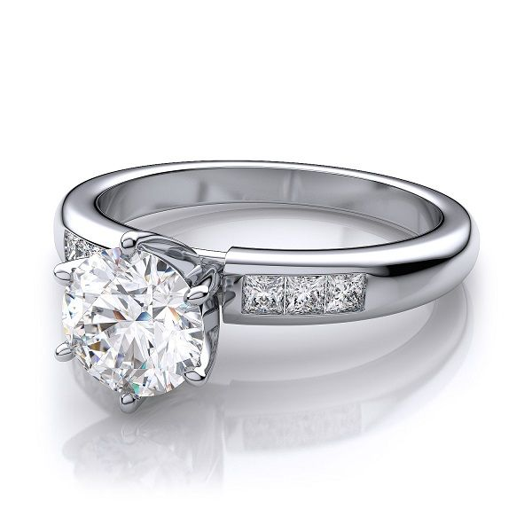 ''Orion'' Channel Set Diamond Engagement Ring Eye catching round cut channel set classic engagement ring contains six (.22cts) beautifully set princess cut side stone diamonds.