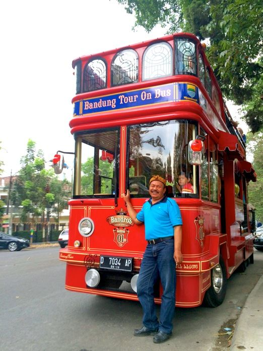 Bandung city tour bus. Bus Captain: Pak Dadang, Bandros's driver posing in front of the stylish city tour bus. (Photo by Icha Rahmanti)