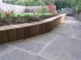Image result for railway sleepers retaining wall