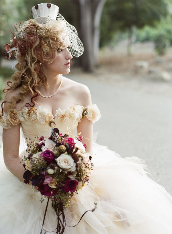 Victorian Steampunk Wedding the dress is beautiful with roses, but the bouquet is luxurious