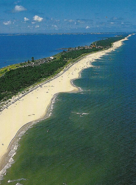 Hel Peninsula is a 35-km-long (22mi) sand bar peninsula in northern Poland separating the Bay of Puck from the open Baltic Sea. It is located in Puck County of the Pomeranian Voivodeship.- http://www.theworldgeography.com/2013/07/incredible-spits.html
