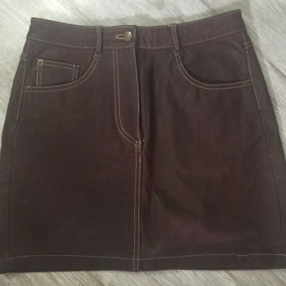 DKNY brown Leather skirt DKNY brown leather skirt. Great for festivals! Some slight marks on back shown in one pic but looks like normal distressed leather anyways DKNY Skirts