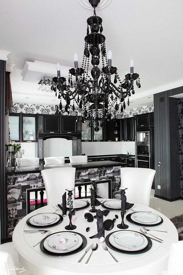 Black and white kitchen with a chandelier.  Also love (but couldn't pull off) the black and white pics on the counter