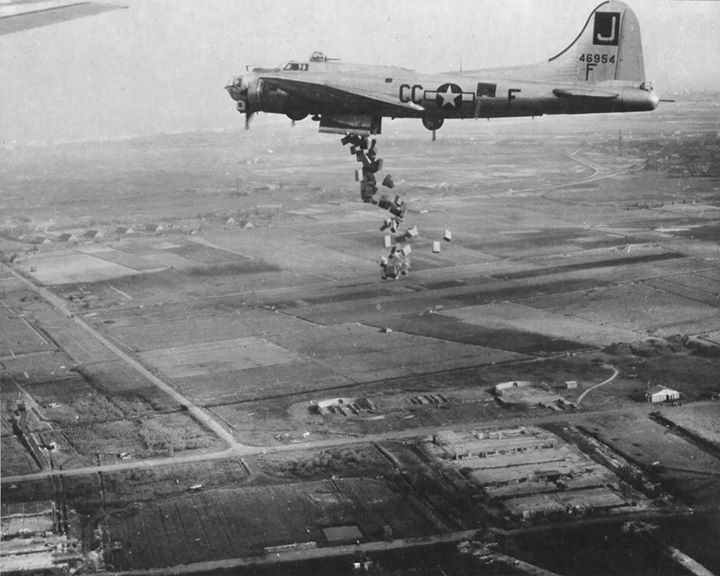 B-17G Fortress Liquid-8-Or of 569th Bomb Squadron dropping cases of 10 in 1 rations into Holland during Operation Chowhound aimed at breaking the famine in western Holland.