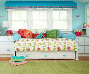 Turquoise handles turn these basic cabinets into cute kids storage. See more ideas for organizing kids' rooms: http://www.bhg.com/decorating/storage/projects/packed-with-storage-kids-room/?socsrc=bhgpin081312kidsroomturqouise#page=5