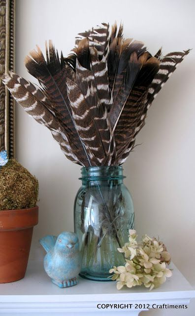 fall centerpiece, feathers in a jar.
