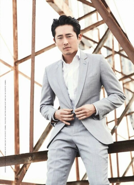 Steven Yeun... looks fabulous in a suit and covered in zombie guts