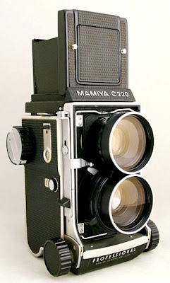 Mamiya C220. Had one of these and photographed several weddings with it. Then sold it. Can't believe I did that. It was fabulous.