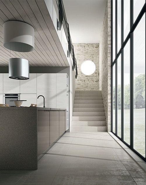 Cocina moderna abierta con comedor Acabados: Laca-Estratificado-Silestone.