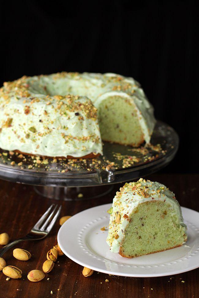 Homemade Pistachio Pudding Cake: no cake pistachio pudding cake topped with pistachio buttercream icing.