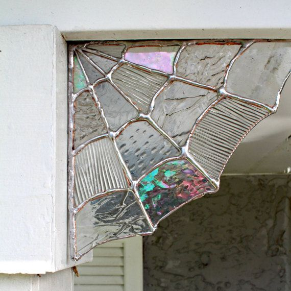 These Stained Glass Spiderweb corners truly make awesome magical & whimsical decor!  Keep up all year or just for Fall & Halloween, This Handcrafted Piece is a showcase piece all in itself.  Adorn in your window & room corners or for your outdoor decor!  Each piece is hand crafted to order and will include a variety of different clear textures & types of glass, making each one individually special & unique JUST like a real spider web