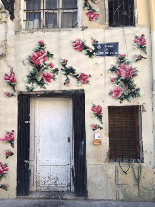 Cross-stitch ups its street cred with artist Raquel Rodrigo's floral patterns, which were woven through wire mesh before being place on the facade of a building in Valencia, Spain.