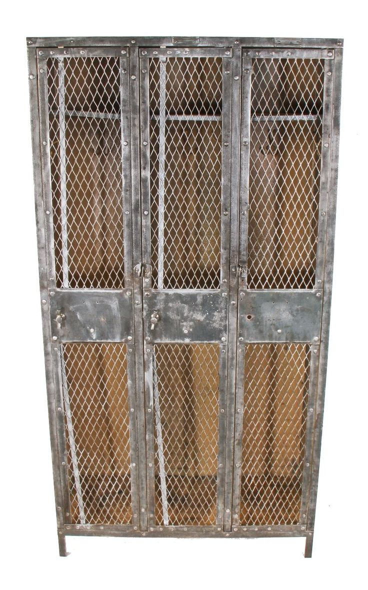 highly desirable early 20th century american industrial 3-unit freestanding cold-rolled riveted joint sheet iron factory lavatory locker with diamond steel mesh doors