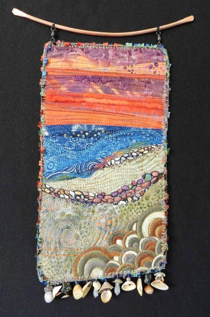 Coastall Sunset.  Fiber art quilt by Eileen Williams