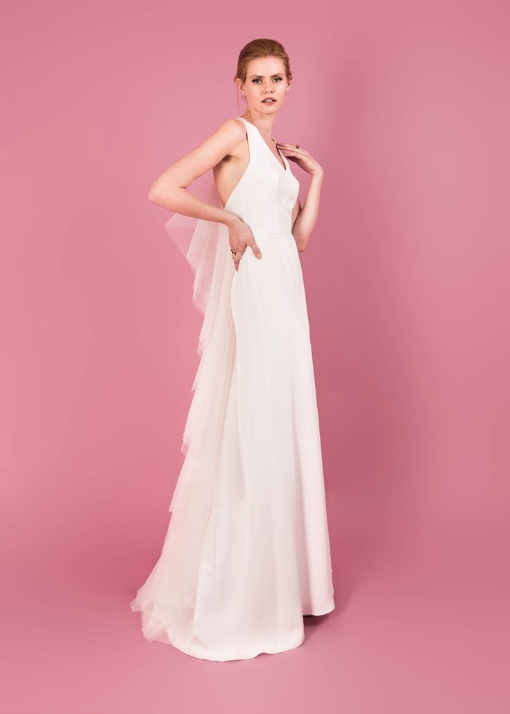 Modern wedding dress for the contemporary bride. Diana dress. Halter neck silk moroccain gown with polka dot tulle back detail.