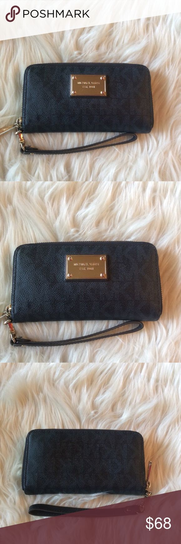 Michael Kors Wristlet Zip around wallet with room for phone, cash, coins and cards. Good condition. Zipper shows a little wear as pictured. 7x4. Should hold a phone up to 3x5.5. Navy blue with gold. MICHAEL Michael Kors Bags Clutches & Wristlets