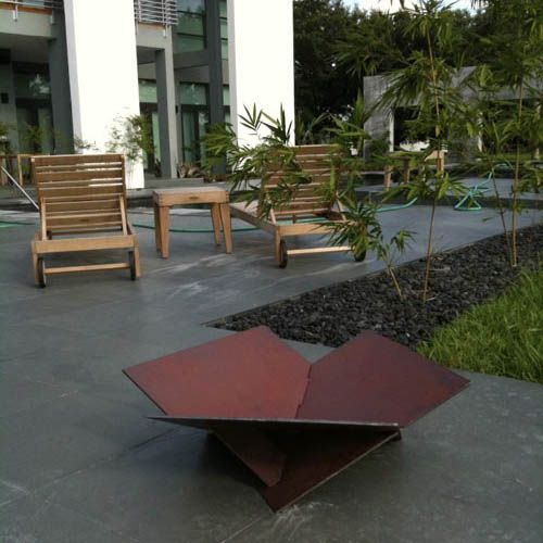 Every home should have a fire pit. This one is made of three specifically cut steel plates.