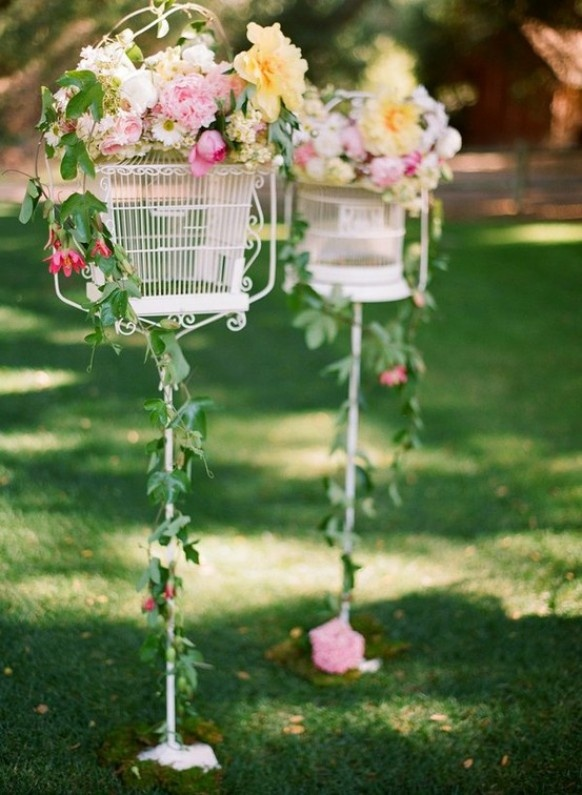 Birdcages Wedding decor.  Maybe for outside