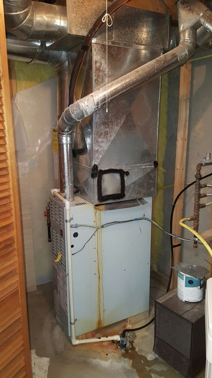 BEFORE- old Carrier furnace with AC coil leaking water.