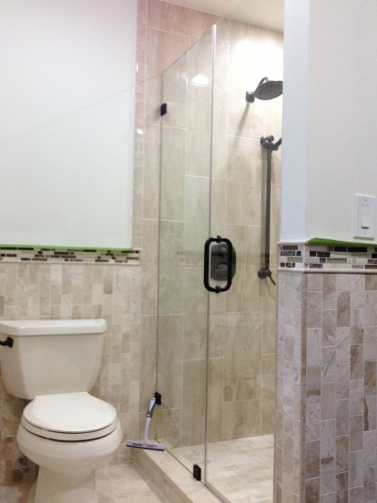 the layout is fixed panel with door that opens and closes freely without obstructing the bathroom fixtures it is an alternative to glass sliding doors