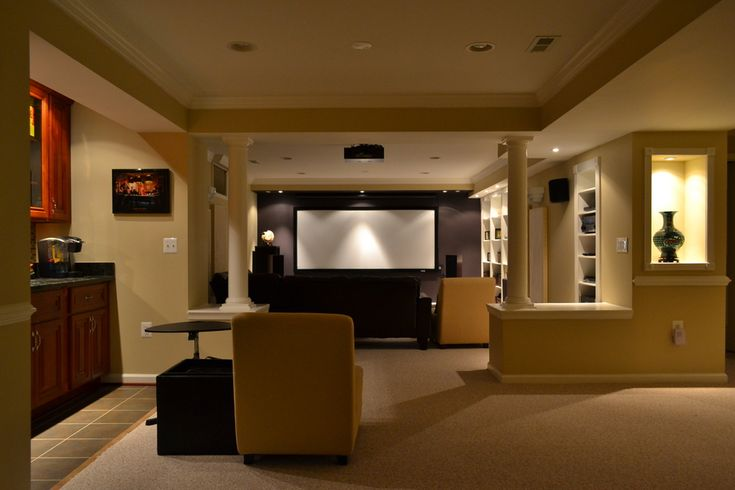 Home theater and gaming area with concession stand/wine bar, game room, and workout area