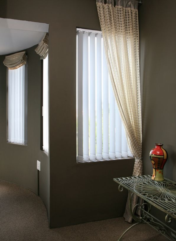 white blinds against feature colour wall