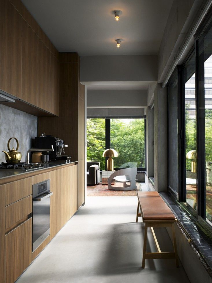 TwoTwoSix Hollywood Road in Hong Kong by Studio Ilse | Remodelista - wood + gray kitchen  www.bulthaupsf.com #design #kitchen #bulthaup