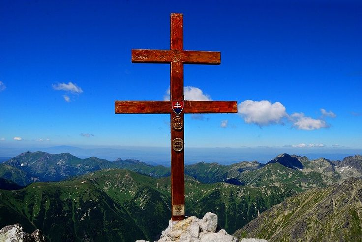 Summit Cross. View from impressive Krivan 2494m. - one of the highest peaks in Tatra Mountains in Slovakia.  Krivan is one of he strongest symbols of Slovakia.