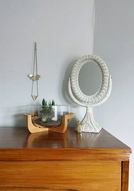 This little white wicker vanity mirror ties this bohemian look together! A well-styled vanity doesn't need much, just the essentials that make your morning routine a little easier.