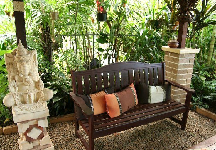Temperate climate tropical garden | GardenDrum Tropical Breeze design Helen Curran Balinese sculpture and rich fabrics give a luxurious feel
