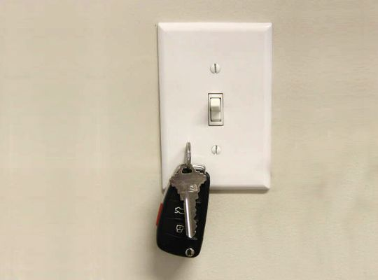 Put a magnet behind the lightswitch plate... brilliant!!!