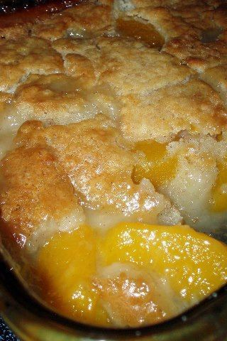 Peach Cobbler 2 cups fresh sliced peaches (or one 29 ounce can of sliced peaches, drained) 1 cup Bisquick mix  1 cup of milk  1/2 teaspoon nutmeg  1/2 teaspoon cinnamon  1/2 cup butter, melted  1 cup of sugar  Preheat oven to 375 degrees   In an 8 x 8 baking dish, stir Bisquick mix, milk, nutmeg and cinnamon together until thoroughly mixed. Stir in melted butter until crust is fully moistened. In a medium mixing bowl, stir sugar and peaches. Spoon peaches over the cobbler crust.