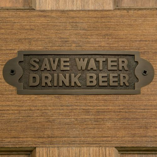 "Encourage conservation with the Solid Brass ""Save Water Drink Beer"" Sign."