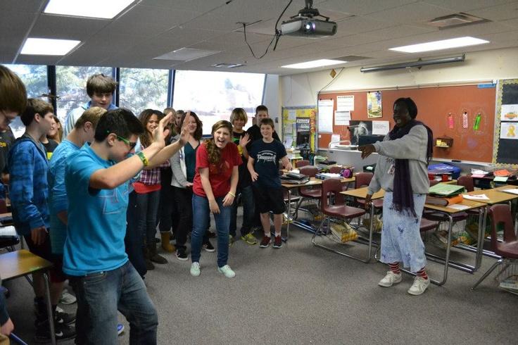 Teacher Exchange Program: Florence teaching American students an Ugandan dance.