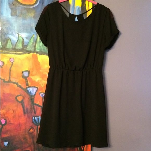 Black Georgette Dress, back yoke cut-outs Excellent condition. Flowy polyester chiffon, elastic waist, lined except for sleeves. Versatile for day/night, multi-season, easy to wear. Cold wash, line dry. No defects.                                           From Nordstrom Dee Elle Dresses
