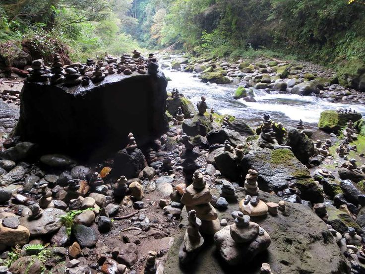 Legend tells how the sun goddess Amanoiwato was lured out of the heavenly rock cave at Takachiho on Kyushu Island, Japan, by other gods to restore light to the world. Visitors erect stone piles here for luck.