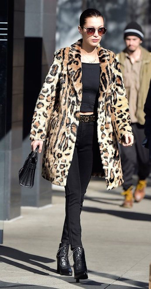 The leopard coat is a supermodel off-duty favorite. Taking cues from Kate Moss, Bella Hadid stepped out in a belly-baring black t-shirt, black jeans, and black heeled boots, letting the coat do all the talking. She accented with a logo belt, gold choker necklace, and oversized sunglasses. Perfection.