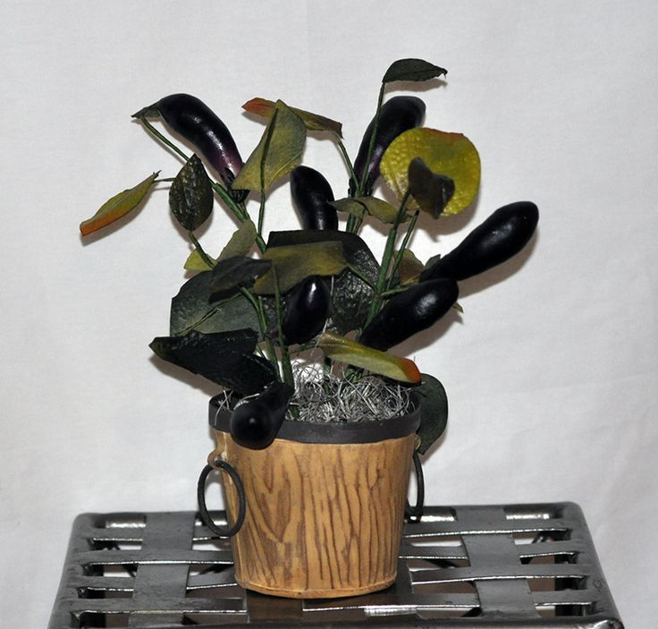 This artificial silk plum colored Egg Plant is in a decorative Metal Container and would brighten up a window ledge or place in the kitchen to inspire your cooking!