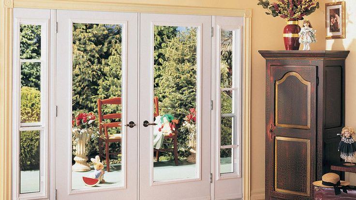 Patio doors kohltech windows and entrance systems for Double door with side windows