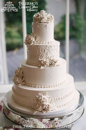 Ivory Elegance Wedding Cake - This wedding cake was inspired by the tradition of the classic wedding cake. The buttercream florals and piping are expertly crafted to make this wedding cake scream elegance.
