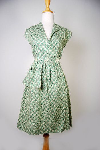 """An authentic vintage reproduction of a timeless favorite cotton day dress! This dress has a great fit and wears comfortably for hot summer days! It is a """"one piece"""" dress with a wide overlap wrap, and"""