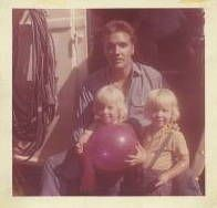 """Twin sisters Pam Ogles(Buske) and Pat Ogles(Martin) - """"Me and my twin sister were in a movie with Elvis Presley in 1961. The movie was filmed near my home town. It was mainly in Yankeetown, FL, some in Inverness, FL, and Ocala, FL. This is part of my private collection. The photo you see i am the one holding the balloon. This photo has his autograph on the back."""""""