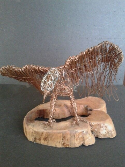 Águila en cobre sobre ciprés $30