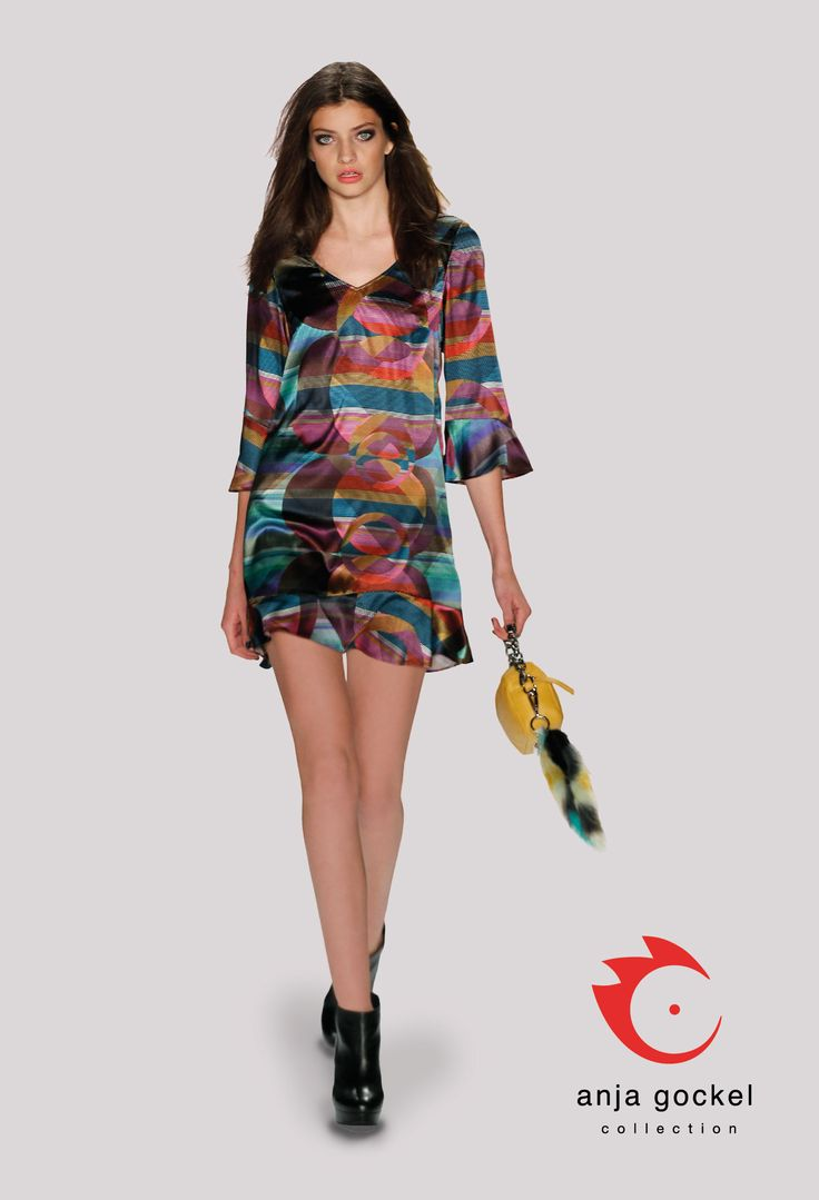 A sweet colorful V-neck dress made of flowing silk satin. The psychedelic print and the valances on sleeves and hemline add a nice playful note this happy outfit.