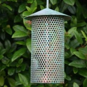 Hanging copper bird feeder: handmade in Ireland and available in our shop: http://www.dyg.ie/accessories/copper-hanging-bird-feeder-irish-made