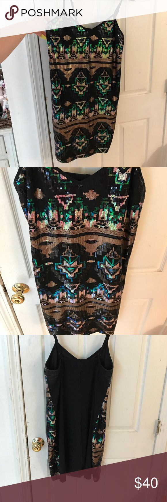 Summer party dress This show stopping number is sooo comfortable! It is a spaghetti strap mini and was only worn a couple of times. The full front aztec pattern made completely from sequins is amazing! This is a Torrid size 2, aka, 16-18 torrid Dresses Mini