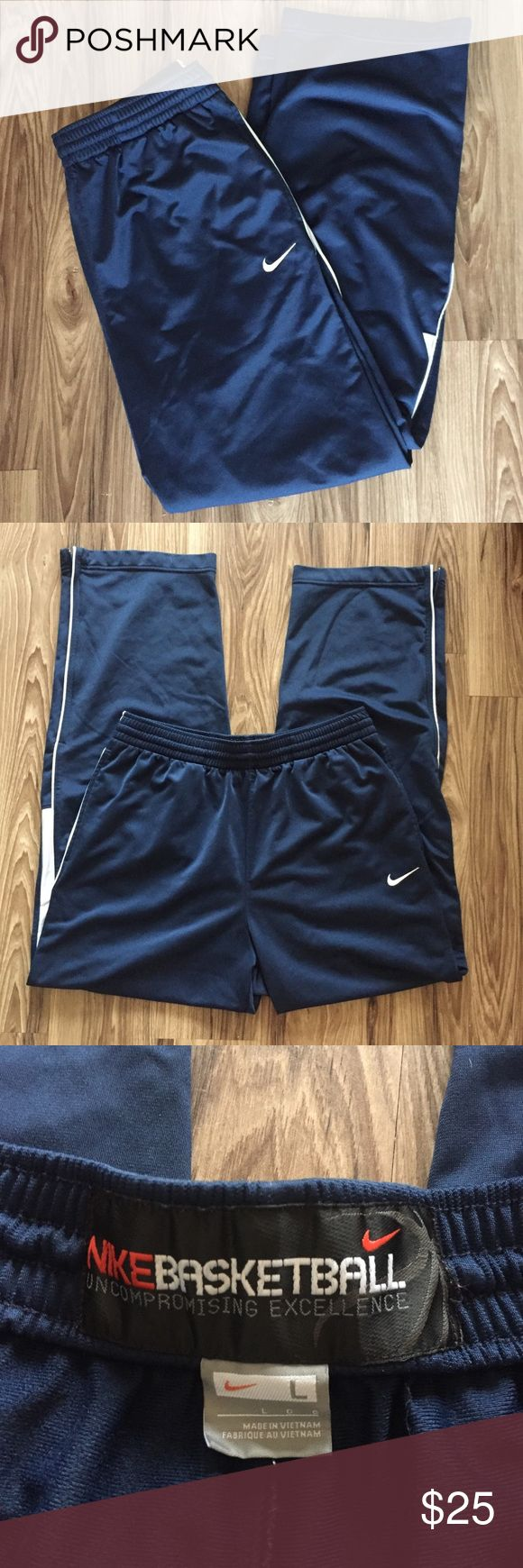 """Nike Navy and White Basketball Pants Size Large Nike Navy and White Basketball Pants Size Large. Pockets on sides. Elasticized waist and adjustable drawstring. Zipper on bottom leg openings. Small ink spots by pockets seen in pics. Approximate measurements: waist: 15.5"""" length: 42"""" Nike Pants Sweatpants & Joggers"""