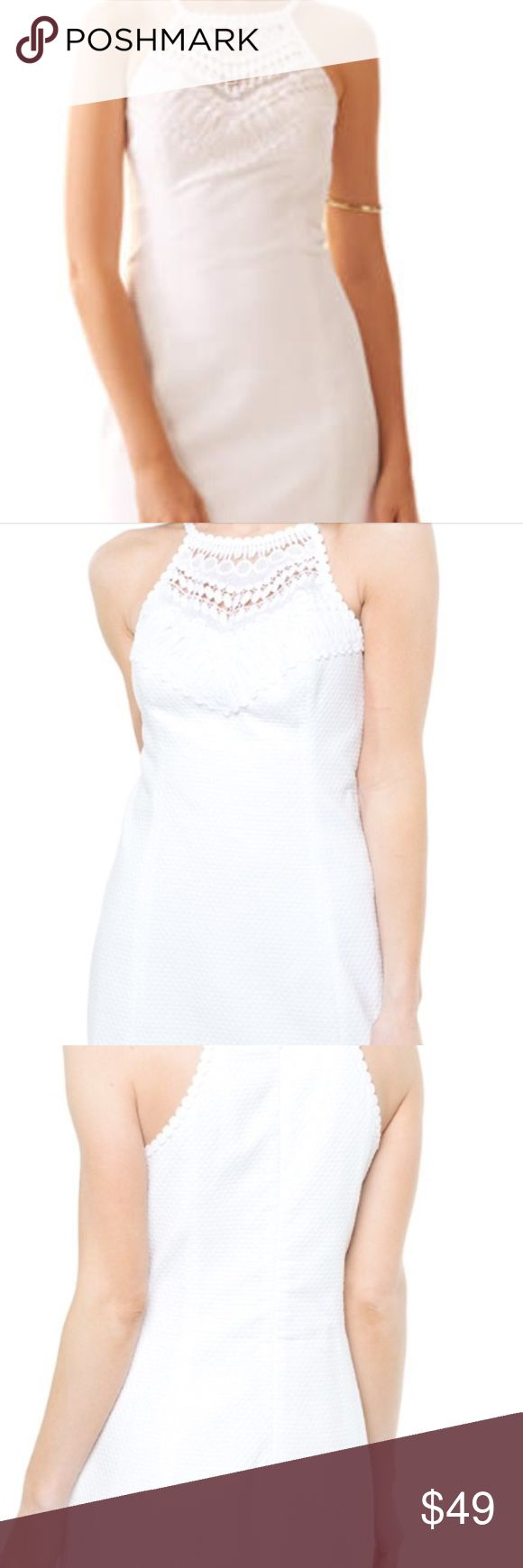 """LILLY PULITZER PEARL LACE NECK DRESS The pearl shift is a favorite of the Lilly white dress collection. This dress is timeless so you'll be able to wear it for years to come. Shift Dress With A Lace Neckpiece. 18"""" From Natural Waist To Hem. Jumbo Pique (100% Cotton). Machine Washable!!! No stains. Worn once for a few hours. It's a stunning dress and will make heads turn. Lilly Pulitzer Dresses"""