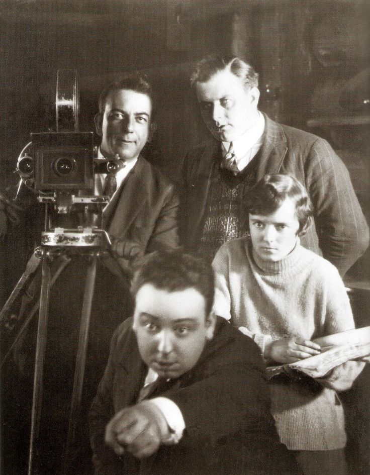 "Alfred Hitchcock directing ""BLACKMAIL"" in 1929 with Alma Reville holding script."